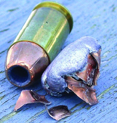 Hollow-point dum-dum bullet before and after firing and impact