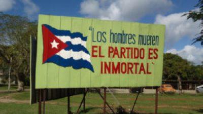 """This billboard in Havana reads, """"Men die; the Party is inmortal."""""""