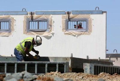 In this photo taken Friday, April 17, 2015, new cells are under construction at Mule Creek State Prison, in Ione, Calif. California prison officials say federal mandates, which led to more expensive private prison beds, and increased spending on prison construction have caused a $3 billion drop in promised budget savings from what was predicted four years ago. – Photo: Rich Pedroncelli, AP