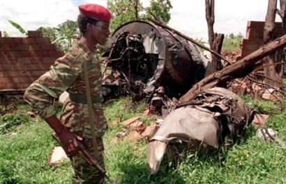 A Rwanda Patriotic Front (RPF) soldier walks by the the site in the capital city Kigali of the April 6, 1994, plane crash that killed Rwanda's President Juvenal Habyarimana and Burundi's President Cyprien Ntaryamirain in this May 23, 1994, photo. - Photo: Jean Marc Boujou, AP