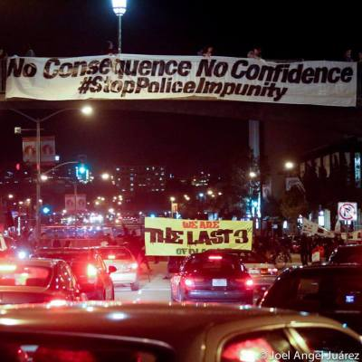 """On Friday night, Jan. 15, during rush hour, """"Reclaim MLK"""" protesters shut down the major intersection of Geary at Webster in the Fillmore, once San Francisco's Black heartland, called """"Harlem of the West"""" until Blacks were driven out, first by Redevelopment, now by gentrification. – Photo: Joel Angel Juárez"""