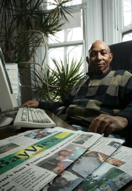 SF Bay View publisher Willie Ratcliff displays some recent papers on Feb. 12, 2007, for a mainstream media reporter. – Photo: Ryan Chalk
