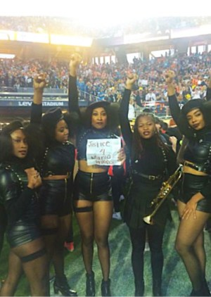 "Thanks to activists Ronnisha Johnson and Rheema Emy Calloway, some of Beyoncé's dancers took a moment to pose with a ""Justice 4 Mario Woods"" sign, living the role of the Black Panthers that their costumes portray. Gwen Woods, the mother of Mario Woods, said, ""Beyoncé gave my son a global stage!"" – Photo: Kofi Ademola Xola"