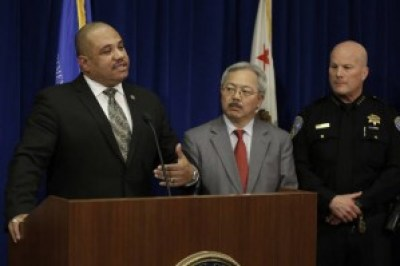 "This photo of U.S. Department of Justice Office of Community Oriented Policing Services (COPS) Director Ronald Davis, San Francisco Mayor Ed Lee, and San Francisco Chief of Police Greg Suhr tops a story on Salon.com about the ""listening session,"" headlined ""'Baghdad by the Bay': San Francisco is slowly devolving into a crypto police state."" – Photo: Ben Margot, AP"