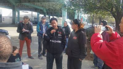 POOR Magazine held a press conference Thursday, March 28, to report the findings of homeless WeSearchers on the trashing of their property and to make their demands for land, a place to live safe and secure in a city invaded by gentrifiers and Super Bowl. Chanelle and Trina, two currently unhoused San Franciso resident WeSearchers, speak at the emergency Jan. 28 press conference as a reporter takes notes, Tiburcio and Tyray listen, and Tony Robles records. – Photo: Poor News Network