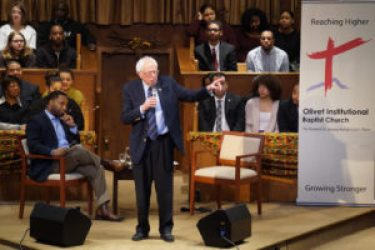 Sen. Bernie Sanders speaks at Olivet Institutional Baptist Church on Cleveland's largely Black east side on Saturday, March 5, to an audience of 800. To the left of Sanders is Olivet senior pastor, Rev. Dr. Jawanza Karriem Colvin. Skeptical expressions on the faces around him changed as Sanders spoke and, by the time he finished, the audience had given him several standing ovations. – Photo: Rhonda Crowder