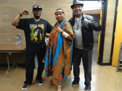 Billy X Jennings, Mama C – Charlotte O'Neal – and Emory Douglas celebrate Huey P. Newton's birthday at the West Oakland Branch Library. – Photo: Wanda Sabir