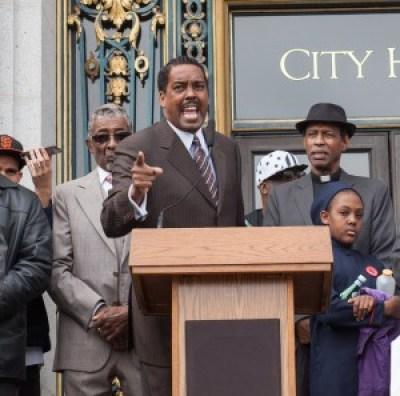 "At the Black-Brown unity rally at City Hall after a federal court refused to hold the police officers who murdered Alex Nieto responsible, Minister Christopher Muhammad told the crowd: ""This is an election year, and this is a big-money Democratic city. … We have no reason to be silent. … We want our supervisors to be angry as hell and fire some of these rogue cops – fire Chief Suhr!"" – Photo: Pax Ahimsa Gethen"