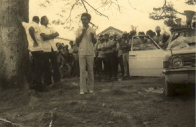 "Dr. Walter Rodney speaks to workers. Commentator Eusi Kwayana says a danger to Rodney that discouraged his return to Guyana was ""the racial cleavage which had taken place among the working people."""