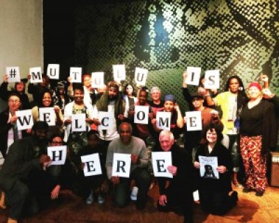 Some of the crowd gathered to spell it out and make it plain: Mutulu is welcome here and everywhere! – Photo: Wanda Sabir