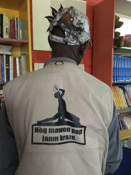 "On the back of this Haitian man's jacket is an image of the iconic Haitian maroon revolutionary with the message: ""The spirit of the Haitian people will never break."" – Photo: Marilyn Langlois"