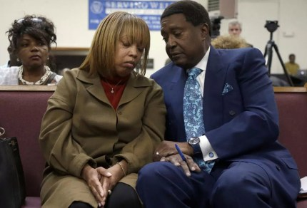 Civil rights attorney John Burris counsels and comforts Gwen Woods, mother of Mario Woods, executed firing squad-style by five officers on Dec. 2, 2015. – Photo: Jeff Chiu, AP