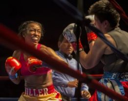 Hitting Flores at will, Miller sets up the straight right to the chest of her opponent. – Photo: Malaika H Kambon
