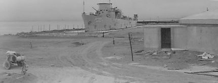 """This is the USS Pandemonium, a 173-foot fixture on Treasure Island for many years, built by the Navy from salvage. It looks like a ship, but it's not. It was for training sailors to scrub radioactive contamination off the fake ship's surfaces. Halyburton and Bigelow Court, later built on the site, are so toxic that, in the late '90s after military families moved out, the Navy fenced them both off, admitting in 2012 that the training may have left behind """"radioactive residue."""""""