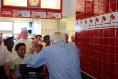 """At In-and-Out Burger in Pinole, the sort of diner that serves the people Bernie Sanders champions, he speaks to the staff. A comment to the photo on his Facebook page reads: """"Their faces speak volumes. No way does Hillary get this much excitement!"""""""