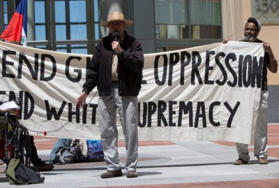 "Dave Welsh of the San Francisco Labor Council described the council's historic support for the people of Haiti. The sign behind him reads, ""End global oppression; end white supremacy."" – Photo: Malaika H Kambon"