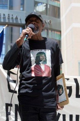 An Oakland community member was inspired to speak of spirituality and its importance in struggle. – Photo: Malaika H Kambon