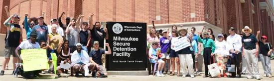 "Supporters of the anti-solitary hunger strikers who are ""Dying to Live"" rally outside a DOC prison in Milwaukee on June 10."