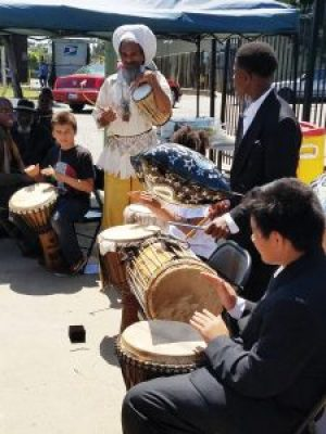 Baba Val Serrant, recently evicted from his longtime home on BlackArthur, speaks on displacement at the Emergency Press Conference while also performing with his drum class from Deecolonize Academy. – Photo: Tiny, Poor News Network