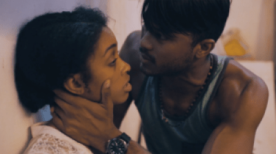 """Gyerlini Clarke as Penny and Aaron Charles as George in a scene from """"Trafficked"""""""