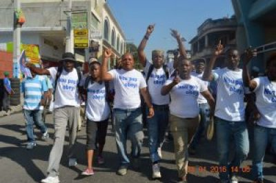 """These Haitian men are not afraid to say, """"We will not obey!"""" – Photo: Haiti Information Project"""