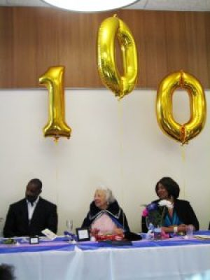 """The brand new Dr. George Davis Senior Center went all out with lavish decorations, including balloons spelling """"100,"""" for Ms. Pickens' 100th birthday party on June 11. It's not often there's such a great milestone to celebrate! – Photo: Anh Le"""