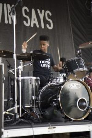 Jarad Dawkin plays drums on tour with Unlocking the Truth band. – Photo courtesy Emerald Gold