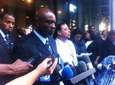 Angry as he must have been, Uncle Bobby calmly faces the press on Nov. 5, 2010, after the sentencing of Johannes Mehserle, the cop who killed Oscar. Jack Bryson, whose two sons were close friends of Oscar and were with him on the BART platform when he was murdered, stands beside him. Though Mehserle spent only a few months in jail, any jail time at all for a killer cop was a major breakthrough. – Photo: Noah Nelson, Youth Radio