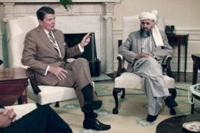 "President Ronald Regan meets in the White House with ""freedom fighter"" Osama bin Laden."