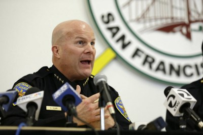 San Francisco Police Chief Greg Suhr speaks during a town hall meeting on April 13, 2016, to update the Mission District neighborhood on the investigation of an officer involved shooting in San Francisco. His rush to judgment after each killing that always exonerated the officers and criminalized the victim so angered Black and Brown communities that, a week after this meeting, the communities united to support the Frisco 5 hunger strikers, whose first demand was the firing of Chief Suhr. Their strike lasted 17 days, and on May 19, Suhr resigned. – Photo: Eric Risberg, AP