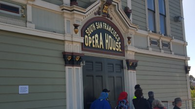 This is the north face of the Opera House, still displaying its original name, which became obsolete when South San Francisco formed itself as a separate city. – Photo: Lee Hubbard