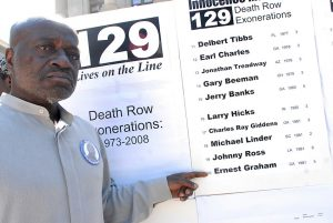 Ernest (Shujaa) Graham points to his name on the list of 129 death row inmates who have been exonerated in the United States since 1973. Graham was acquited of charges in 1981 after spending 5 years on death row in California.