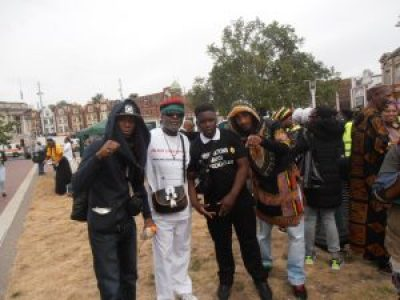 Baba Jahahara with youth leaders of the Reparations March Outreach Team at Windrush Square, in Brixton