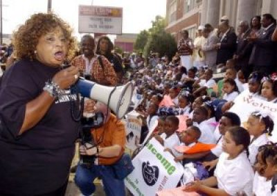 On Sept. 6, 2006, a year after Katrina, Martin Luther King Charter School principal Doris Hicks rallies students, teachers, parents and government officials to demand the former Colton Academy be opened so their school year can begin. – Photo: Eliot Kamenitz, NOLA