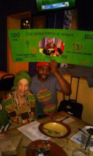 Paradise presents Sister Makinya, the First Lady of Kwanzaa, with the very first award from the Black Elders Fund. The party was Feb. 24, 2016, at Kingston 11 Jamaican Restaurant.