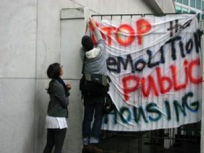 The years-long battle over the thousands of homes in New Orleans public housing that had survived Katrina unscathed was fierce and passionate, but they were ultimately demolished – an act of blatant racism to drive Blacks from the city. This is a 2007 protest at City Hall. – Photo: Gpax