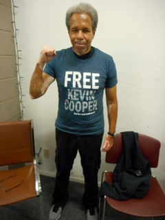 Albert Woodfox, looking young, fit and vigorous, wears the Free Kevin Cooper T-shirt he was given at the reception in his honor sponsored by ANSWER on Sept. 7, 2016. He was released from prison only last Feb. 19. – Photo: Carole Seligman