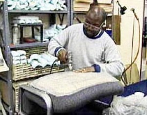 A prisoner builds furniture for a company called Furniture Medic – in prison, where concern for workers' safety is scarce. One prisoner told of having to smash the glass on old TVs and computer screens all day with no protection from the flying glass.