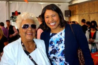 Bay View columnist Rochelle Metcalfe and Board of Supervisors President London Breed share a bright moment at the April 13, 2015, Giants home opener. We're eager to welcome Rochelle back home to her page. – Photo: Harrison Chastang