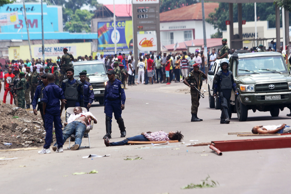 https://i1.wp.com/sfbayview.com/wp-content/uploads/2016/10/Congolese-protest-election-delay-bodies-lie-in-street-Kinshasa-901916-by-John-Bompengo-AP.jpeg