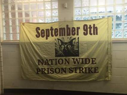 This banner appears to be hanging on a wall of Holman Prison.