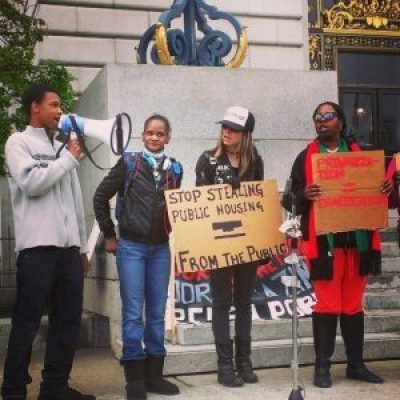 "Sabrina Carter and her son (far left) are joined by Tiny and Queennandi of POOR to protest the RAD program to privatize public housing that evicted them in 2014. ""They criminalized my son so they could evict my family,"" said Sabrina, single mother and resident of public housing building Plaza East in the increasingly gentrified Fillmore district of San Francisco. – Photo: PNN"
