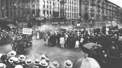 "In this scene from Marcus Garvey's UNIA parade in Harlem in 1924, a sign in the lead car is visible reading ""The New Negro has no fear."""