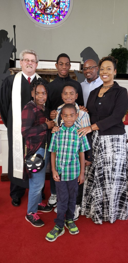 Pastor-Eric-Theresa-Payne-their-4-children-w-Pastor-Nolin-at-United-Methodist-Church-Belle-Glade-FL, Pastor Eric Payne paroled, then snatched from his church, wife, four children back to prison for clerical error, Behind Enemy Lines