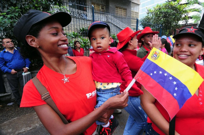 Mothers-baby-protest-in-Venezuela-by-Bill-Hackwell-web, Happy Mother's Day to those struggling to raise families while living in poverty, under sanctions and war, World News & Views