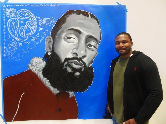 Russell-Craig-of-Mural-Arts-Philadelphia-unveils-1-of-2-Nipsey-Hussle-murals-started-at-Arts-in-Corrections-Master-Artist-workshop-gifts-to-Toyin-Moses-0619-by-Wanda, Wanda's Picks for July 2019, Culture Currents