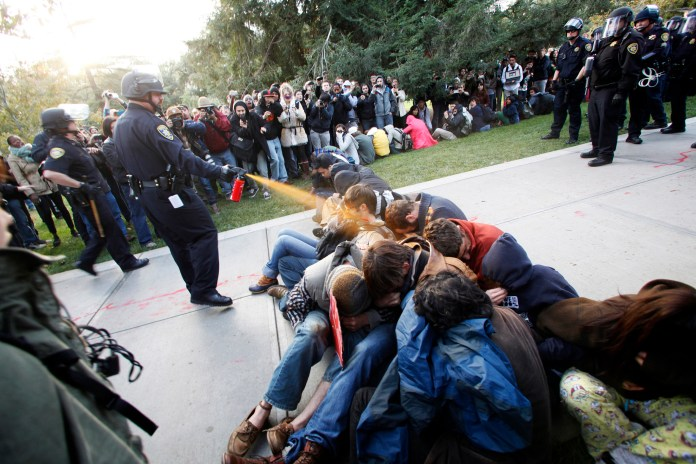 UC-Davis-cop-peppersprays-sit-in-protesting-students-111811-by-Wayne-Tilcock-AP, Chancellor's orchestrated public lynching at Contra Costa College, Local News & Views