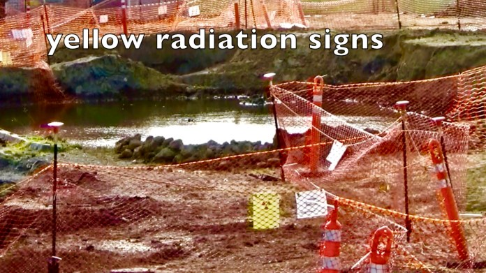 Treasure-Island-radiation-signs-hung-on-orange-snow-fences-around-'potholes'-by-Carol-Harvey, Navy removes an estimated 163+ new radiation deposits from two toxic dumps and dangerously radioactive soil from under occupied Treasure Island home, Local News & Views