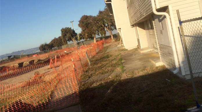 Treasure-Island-toxic-'potholes'-inside-orange-snow-fences-feet-from-Northpoint-Drive-homes-by-TI-resident, Navy removes an estimated 163+ new radiation deposits from two toxic dumps and dangerously radioactive soil from under occupied Treasure Island home, Local News & Views