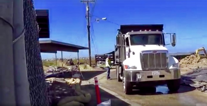 Treasure-Island-truck-with-radioactive-soil-exiting-Bayside-Solid-Waste-Disposal-Area-gate-by-Carol-Harvey, Navy removes an estimated 163+ new radiation deposits from two toxic dumps and dangerously radioactive soil from under occupied Treasure Island home, Local News & Views